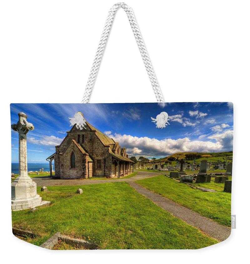 Saint Tudno Weekender Tote Bag featuring the photograph Saint Tudno by Adrian Evans