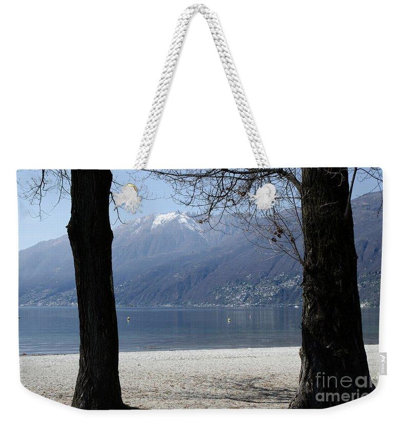 Beach Weekender Tote Bag featuring the photograph Sand Beach On An Alpine Lake by Mats Silvan