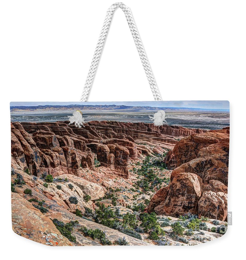 Sandstone Weekender Tote Bag featuring the photograph Sandstone Fins Of Arches National Park by Gary Whitton