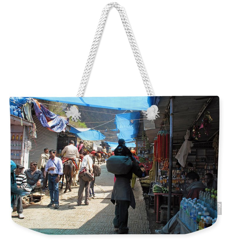 Vaishno Devi Weekender Tote Bag featuring the photograph Scene At The Climbing Path Leading To The Vaishno Devi Shrine In Jammu And Kashmir State In India by Ashish Agarwal