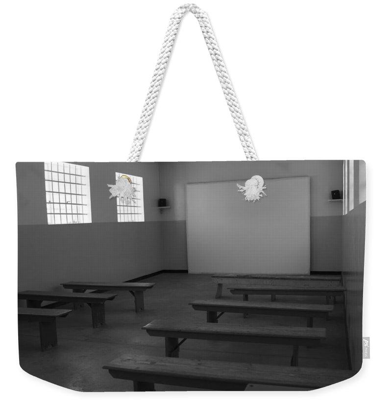 Robben Island Weekender Tote Bag featuring the photograph School Of Defiance by Aidan Moran