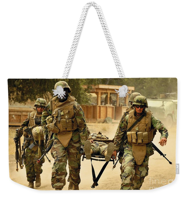 Naval Mobile Construction Battalion Weekender Tote Bag featuring the photograph Seabees Conduct A Mass Casualty Drill by Stocktrek Images