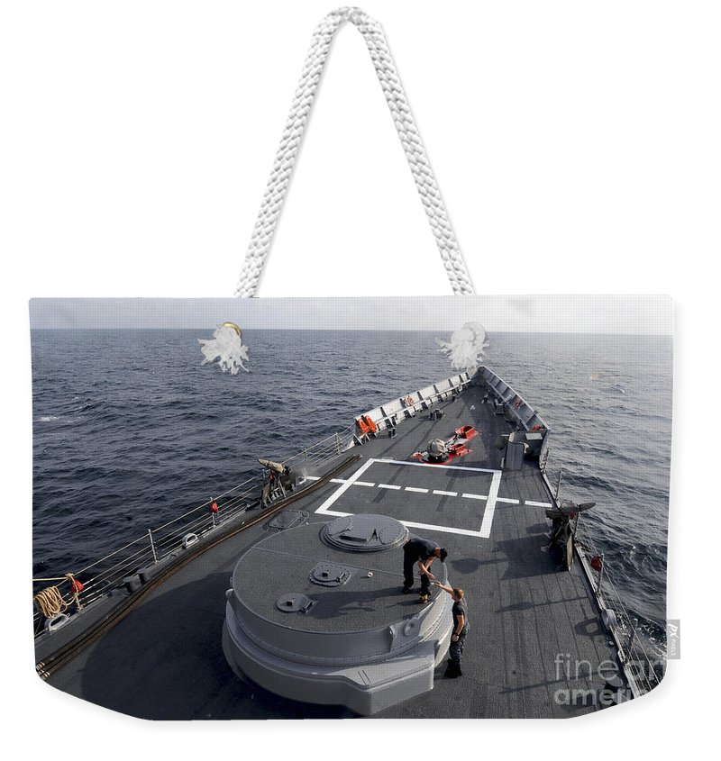 Military Weekender Tote Bag featuring the photograph Seamen On The Forecastle by Stocktrek Images