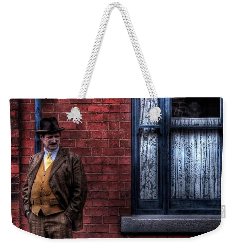 Art Weekender Tote Bag featuring the photograph See No Evil by Yhun Suarez
