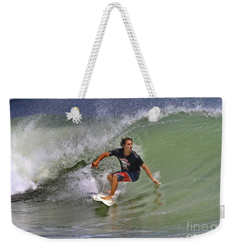 Surfer Weekender Tote Bag featuring the photograph September Ponce Inlet Surfer by Deborah Benoit