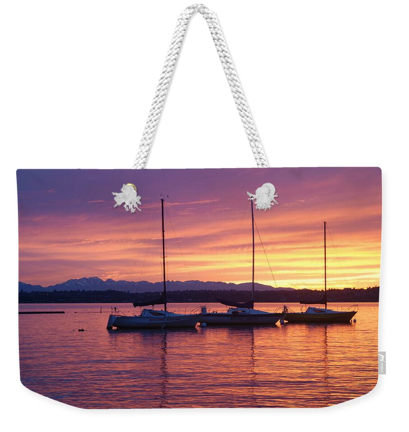 Sunset Weekender Tote Bag featuring the photograph Serene Sunset by Michael Merry