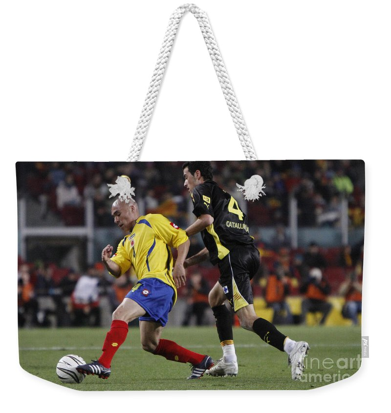 Sergio Weekender Tote Bag featuring the photograph Carlos Busquets by Agusti Pardo Rossello