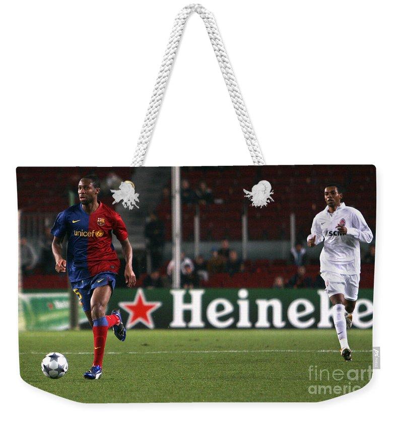 Seydou Weekender Tote Bag featuring the photograph Seydou Keita Playing by Agusti Pardo Rossello