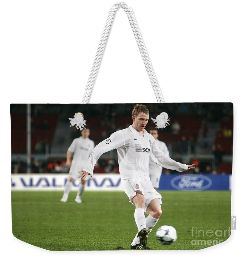 Shaktar Weekender Tote Bag featuring the photograph Shaktar Player by Agusti Pardo Rossello