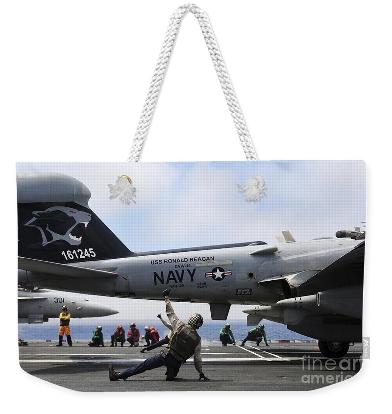 Flight Deck Weekender Tote Bag featuring the photograph Shooters Signal Satisfactory Final by Stocktrek Images