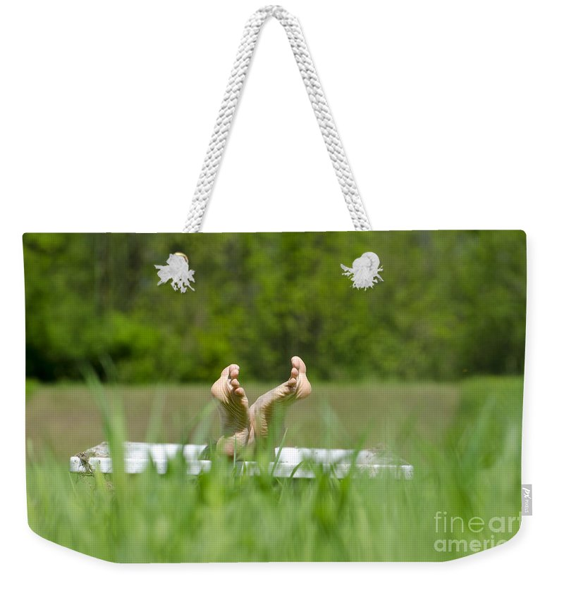 Woman Weekender Tote Bag featuring the photograph Showing Her Feet by Mats Silvan