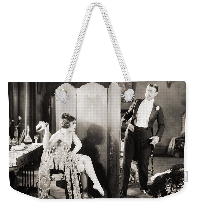 -ecq- Weekender Tote Bag featuring the photograph Silent Film Still: Legs by Granger