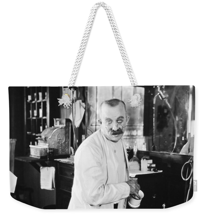 -barbers & Beatuy Salons- Weekender Tote Bag featuring the photograph Silent Still: Barber Shop by Granger