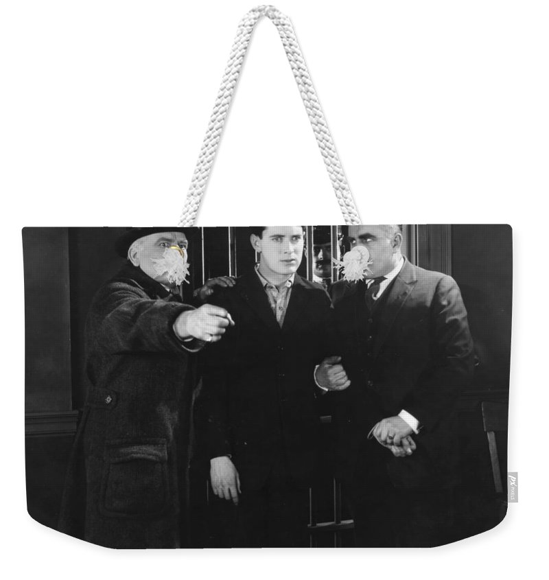 -crime: Prison & Punishment- Weekender Tote Bag featuring the photograph Silent Still: Punishment by Granger
