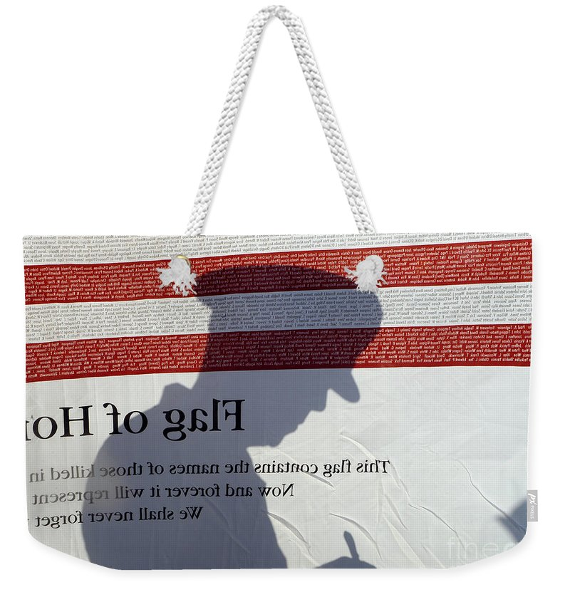 Freedom Weekender Tote Bag featuring the photograph Silhouette Of A Specialist Taking Notes by Stocktrek Images