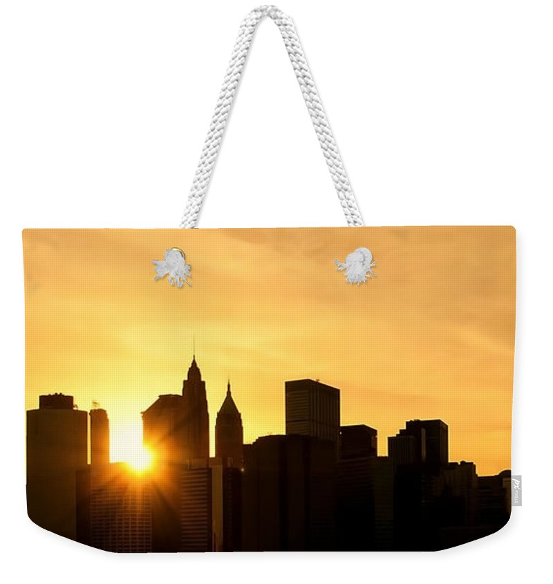 America Weekender Tote Bag featuring the photograph Silhouetted Manhattan by Svetlana Sewell