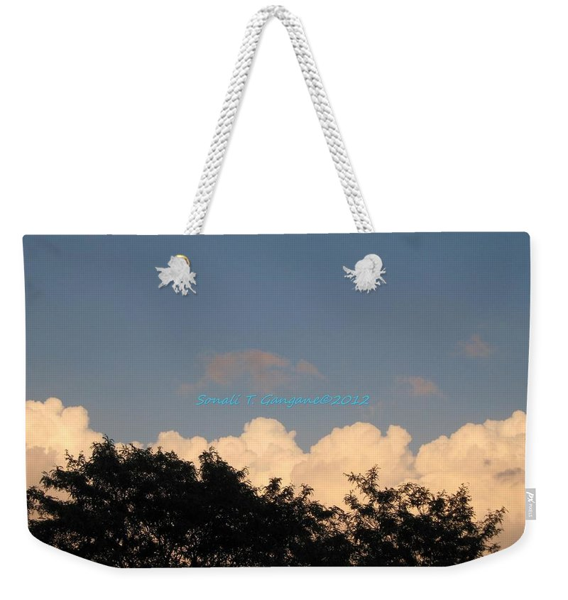 Silver Clouds Weekender Tote Bag featuring the photograph Silver Layer by Sonali Gangane