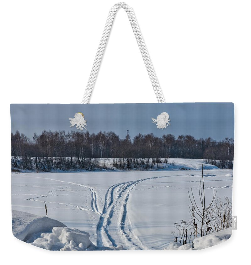 Auto Weekender Tote Bag featuring the photograph Ski Track On The River by Michael Goyberg