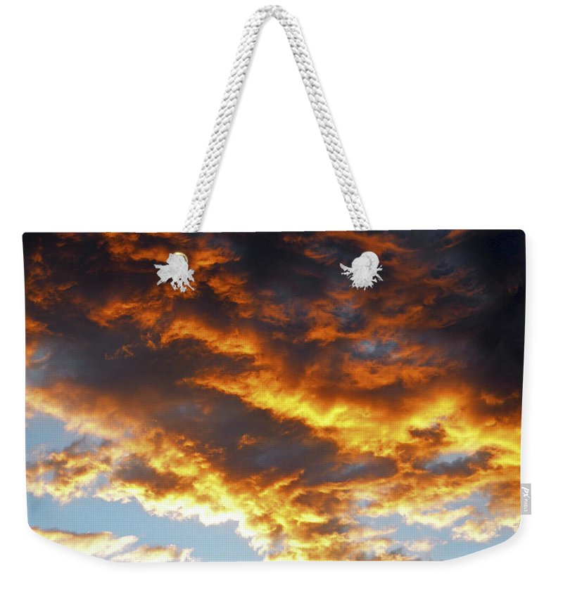Clouds Weekender Tote Bag featuring the photograph Skyfire by Frank Wilson