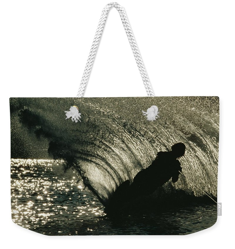 Subject Weekender Tote Bag featuring the photograph Slalom Waterskier Silhouette by Skip Brown