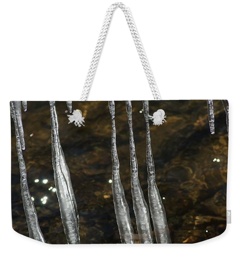 Ice Weekender Tote Bag featuring the photograph Sliding by Joseph Yarbrough