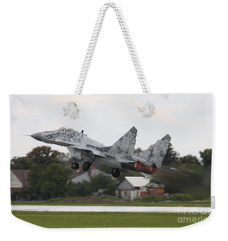 Horizontal Weekender Tote Bag featuring the photograph Slovak Air Force Mig-29 Fulcrum Taking by Timm Ziegenthaler