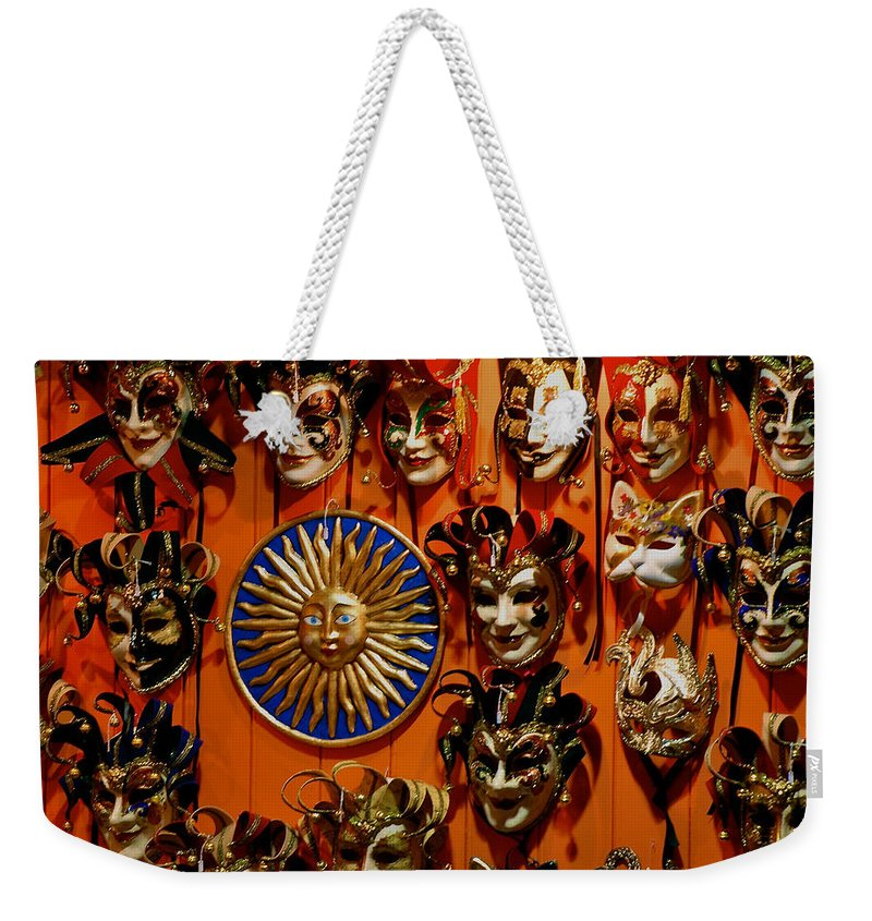 Harlequin Masks Weekender Tote Bag featuring the photograph Smiling Fascination by Eric Tressler