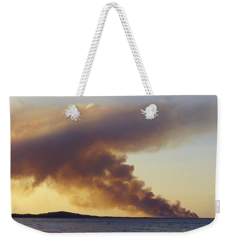 Noosa Weekender Tote Bag featuring the photograph Smoke From A Wildfire Billows by Jason Edwards