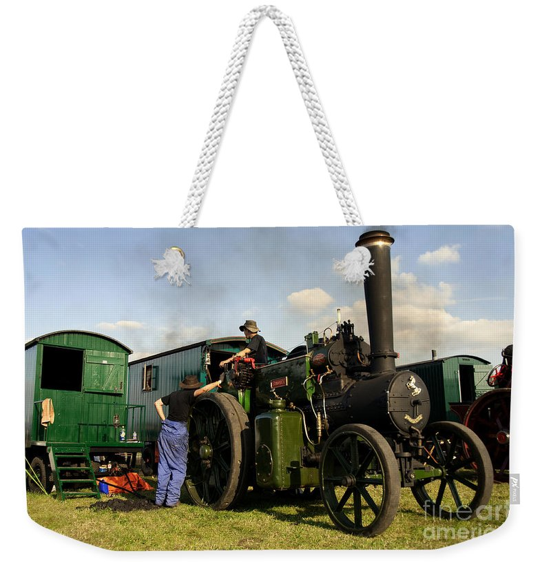 Great Weekender Tote Bag featuring the photograph Smokey And The Vans by Rob Hawkins