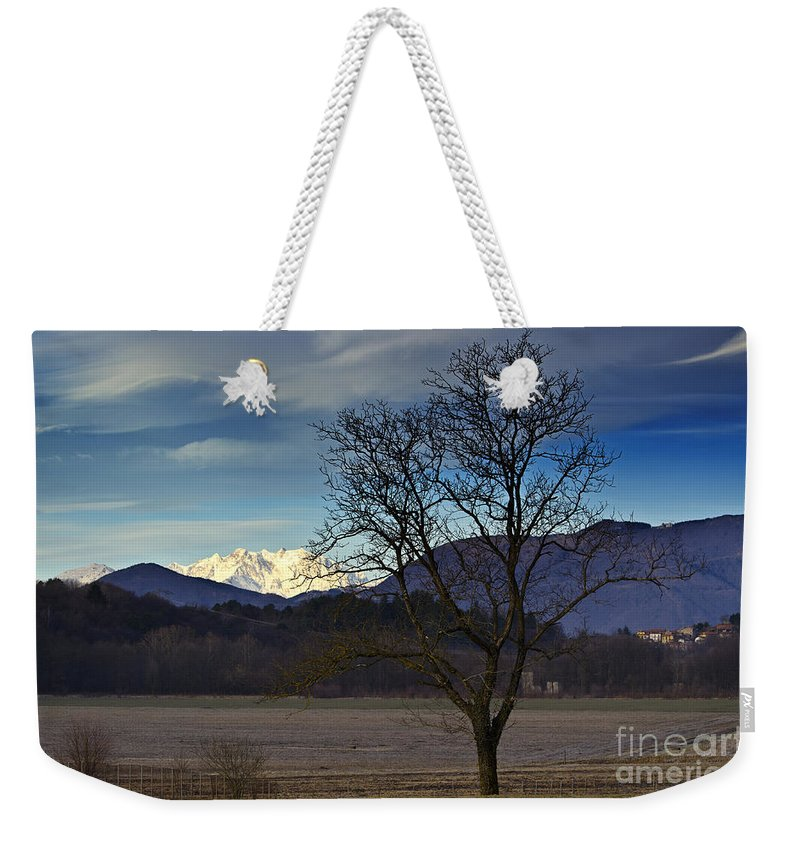Trees Weekender Tote Bag featuring the photograph Snow-capped Monte Rosa by Mats Silvan
