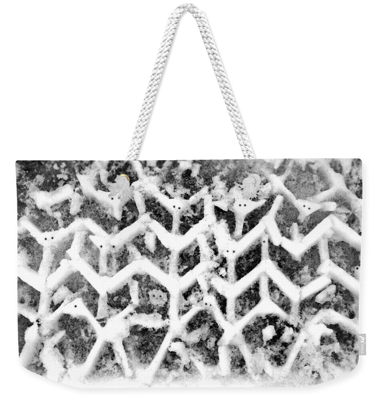 Snow Weekender Tote Bag featuring the photograph Snowmen by Charles Stuart
