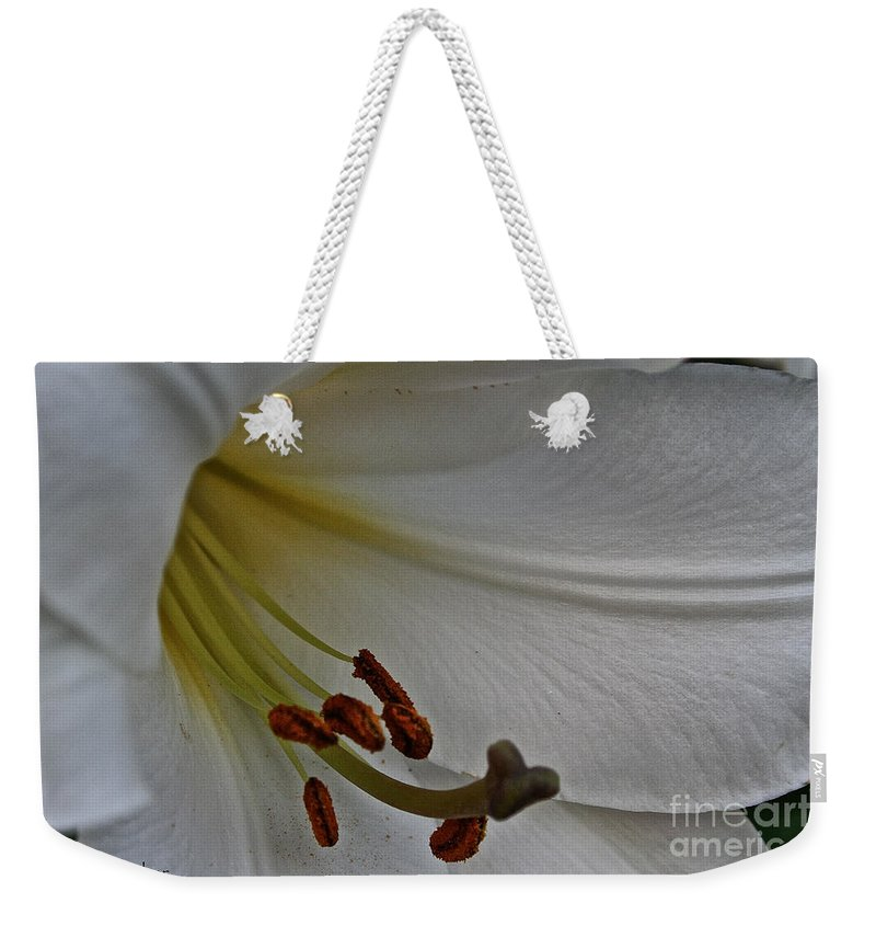 Outdoors Weekender Tote Bag featuring the photograph Snowy Lily by Susan Herber