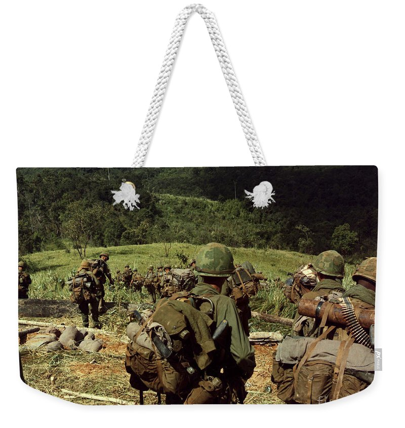 Dak To Weekender Tote Bag featuring the photograph Soldiers Descend The Side Of Hill 742 by Stocktrek Images