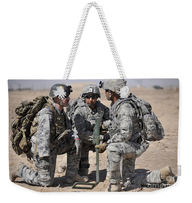 Iraq Weekender Tote Bag featuring the photograph Soldiers Discuss A Strategic Plane by Stocktrek Images