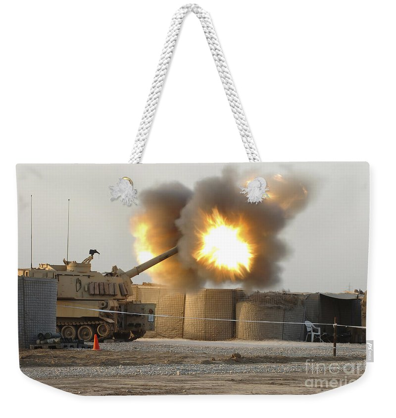 Camp Taji Weekender Tote Bag featuring the photograph Soldiers Fire The Howitzers by Stocktrek Images