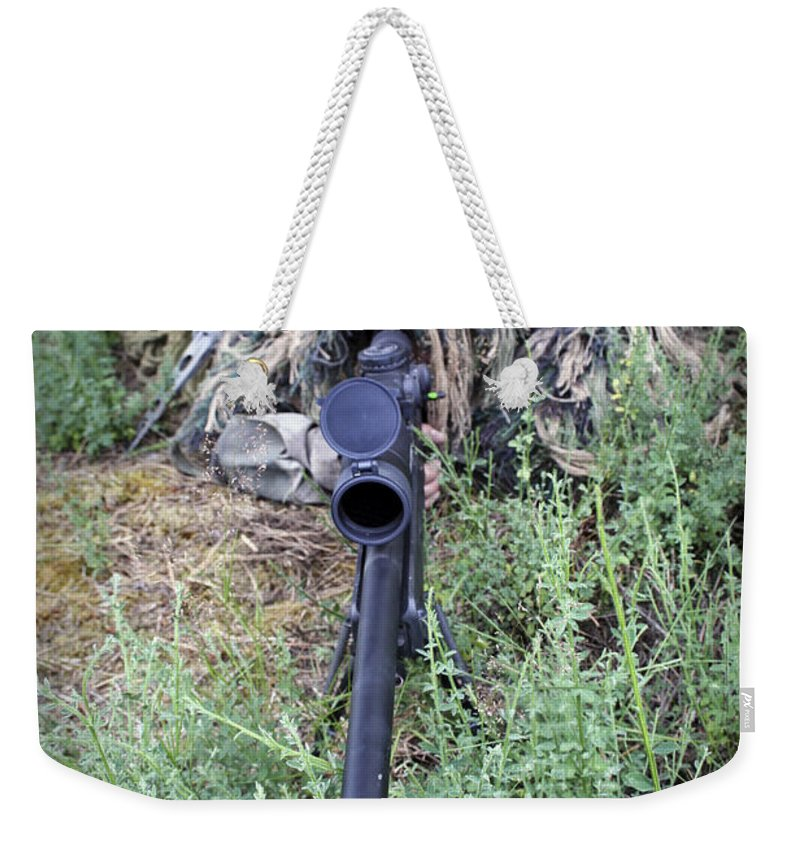 Stealth Weekender Tote Bag featuring the photograph Soldiers Practice Sniper Skills by Stocktrek Images
