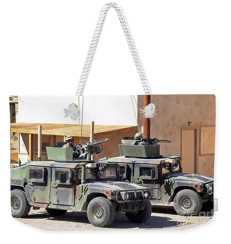 Turret Weekender Tote Bag featuring the photograph Soldiers Provide Overwatch For Fellow by Stocktrek Images