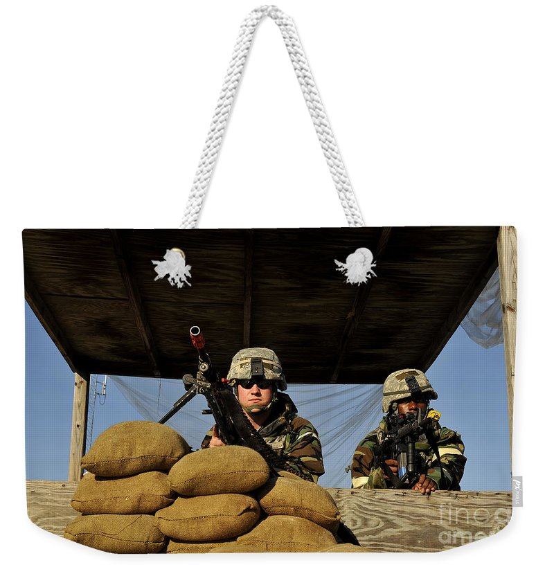 Assault Weapons Weekender Tote Bag featuring the photograph Soldiers Provide Security by Stocktrek Images