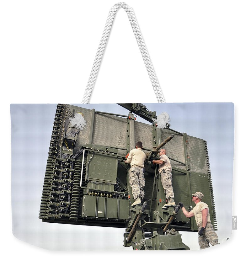 Radar Weekender Tote Bag featuring the photograph Soldiers Set Up A Tps-75 Radar by Stocktrek Images