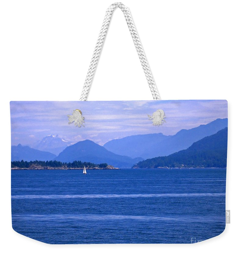 Sailboat Weekender Tote Bag featuring the photograph Solitary Sailing by Ann Horn