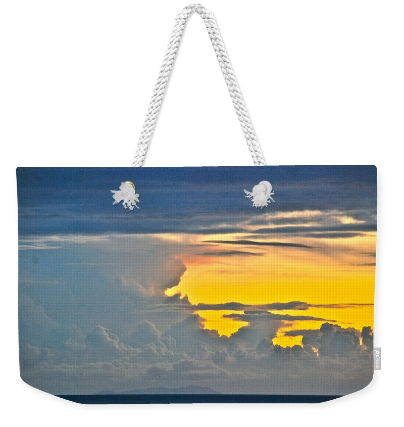 Sky Weekender Tote Bag featuring the photograph South Seas Yellow by Eric Tressler