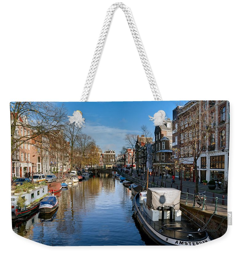Holland Amsterdam Weekender Tote Bag featuring the photograph Spiegelgracht And Ship Amsterdam by Juan Carlos Ferro Duque