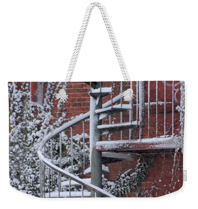 Staircase Weekender Tote Bag featuring the photograph Spiral Staircase With Snow And Cooper's Hawk by Ronald Grogan