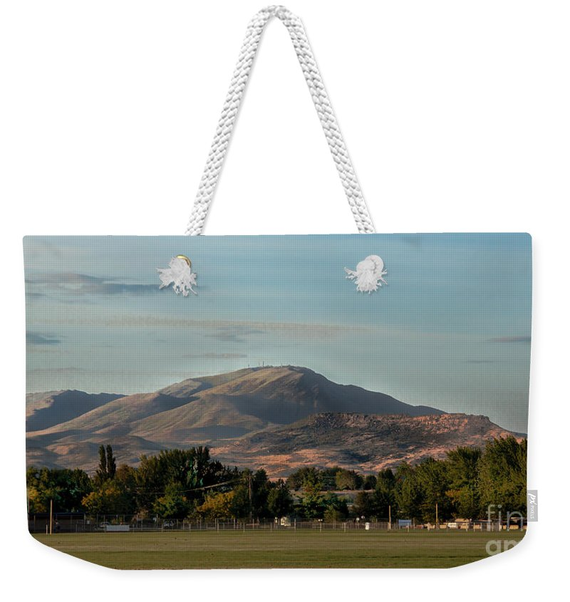 Sport Complex. Squaw Butte Weekender Tote Bag featuring the photograph Sport Complex And The Butte by Robert Bales