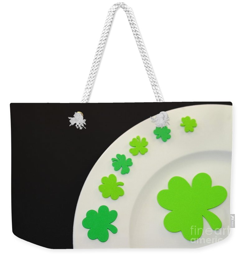 Patrick Weekender Tote Bag featuring the photograph St. Patrick's Day Plate by Henrik Lehnerer