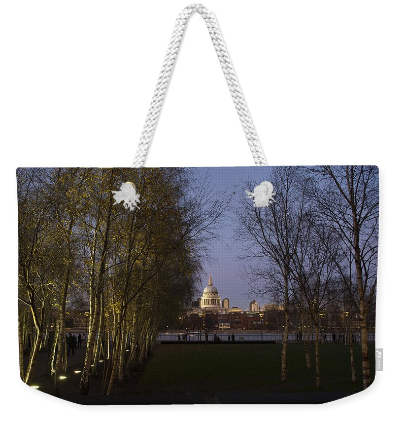 London Weekender Tote Bag featuring the photograph St Paul's With Silver Birches by Gary Eason