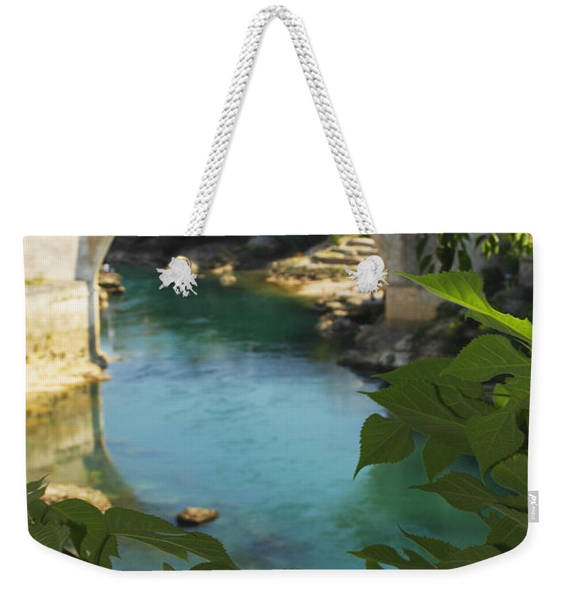 Blue Sky Weekender Tote Bag featuring the photograph Stari Most Or Old Town Bridge Over The by Trish Punch