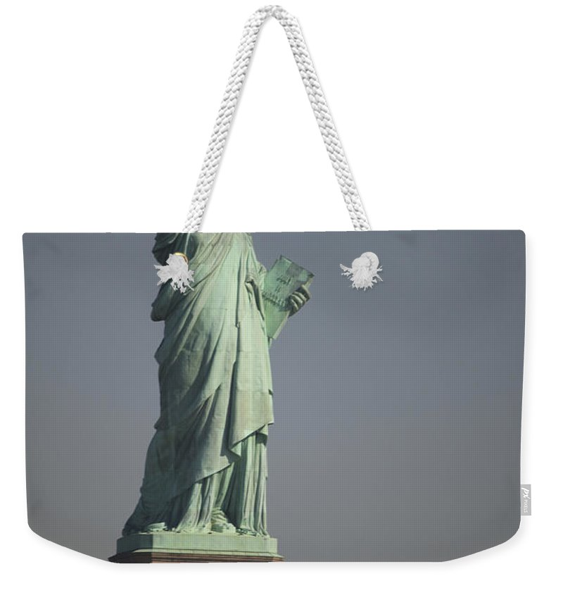 Liberty Island Weekender Tote Bag featuring the photograph Statue Of Liberty, New York, Usa by Stocktrek Images