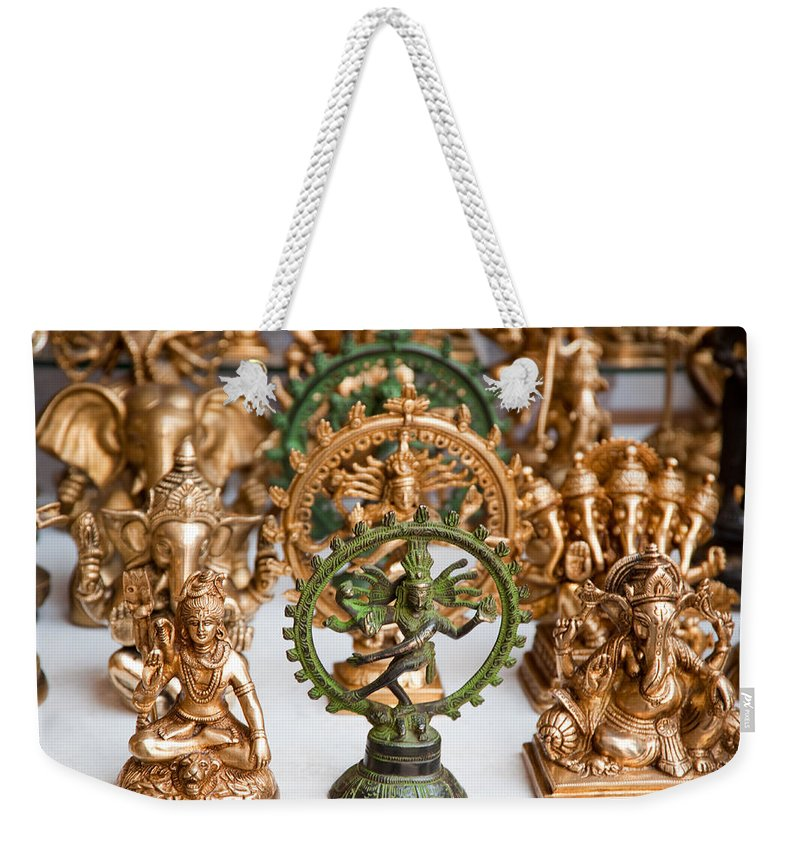 Statue Weekender Tote Bag featuring the photograph Statues For Sale Of Hindu Gods by Ashish Agarwal