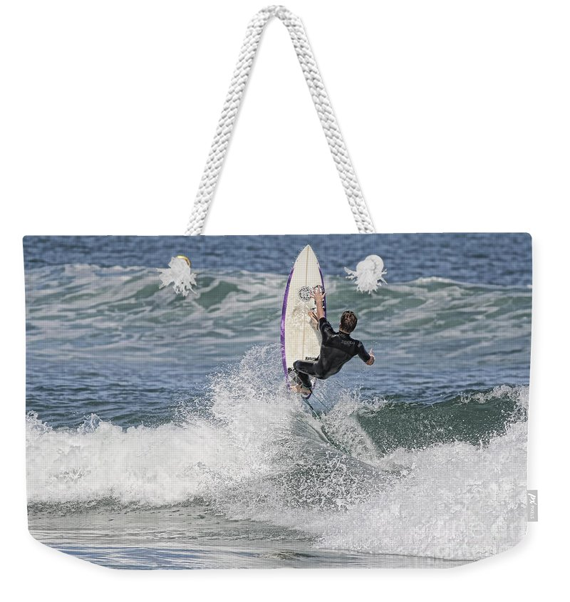 Surfer Weekender Tote Bag featuring the photograph Staying On The Board by Deborah Benoit
